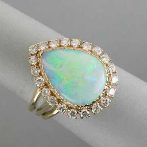 Pearshaped opal and diamond ring ca 1960 pearshaped opal cabochon approx 85 cts framed by fine brilliant cut diamonds approx 88 ct tw in 14k yg 65 dwt gw 10 gs gw size 7 14
