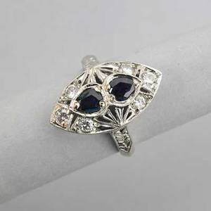 Art deco diamond and sapphire cocktail ring pierced navetteshaped ring with faceted pear shaped sapphires approx 66 ct tw and diamonds approx 40 ct tw 29 dwt 46 gs size 5 12