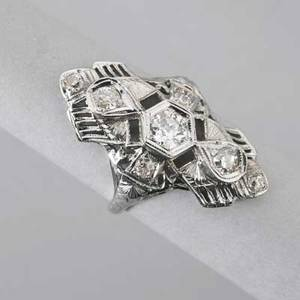 Art deco diamond dinner ring ca 1925 marquiseshaped pierced and chased seven oec diamonds approx 82 ct tw in 14k wg 25 dwt 4 gs 1 14 size 6