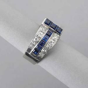 Art deco diamond sapphire 18k white gold ring ca 1935 odeonesque design rows of oec diamonds approx 110 cts tw and calibrated sapphires 5 dwt 77 gs size 8 12 note this lot is being