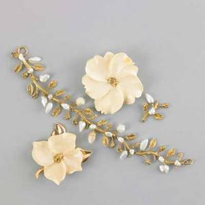 Gold foliate jewelry with mastadon ivory and pearls three pieces 20th c two ivory brooches with nuggets centers one with 10k foliage 18k and river pearl bracelet with spare link 228 dwt gw 3