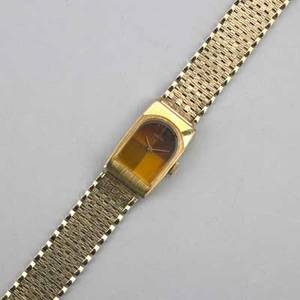 Seiko mechanical watch on 14k gold bracelet gilt metal watch with amber colored enamel face textured bricklink gold bracelet 273 dwt gw 424 gs gw note this lot is being sold to benefit man