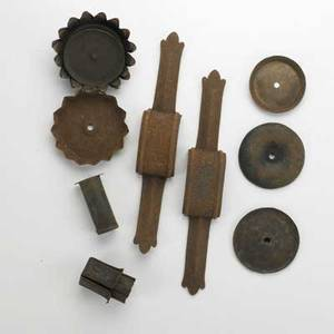 Samuel yellin metalworkers grouping of approximately 100 wrought pierced and shaped iron implements late 20th c brackets candle cups etc unmarked