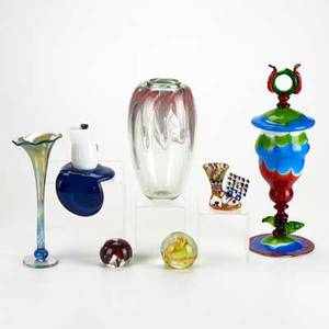 Studio glass seven pieces james nadal lidded goblet art reed bud vase vase with pulled internal decoration two paperweights chamberstick and shelf candlestick most signed some illegibly tal
