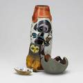 Fantoni four ceramic pieces large leatherwrapped vase with figures two ashtrays and perched owl all marked vase 14