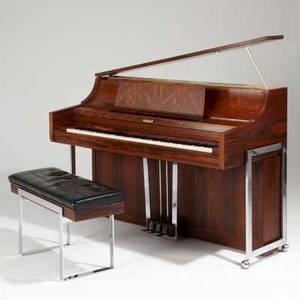 Kimball co spinet piano and bench chicago ca 1970 rosewood ivory polished chromed steel oak and vinyl piano 40 x 58 12 x 25 12 bench 19 12 x 34 x 13 international bids and bids