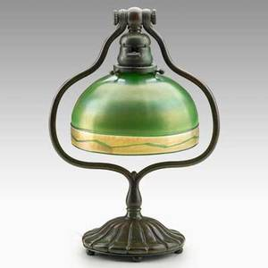 Tiffany studios adjustable table lamp new york patinated bronze favrile glass shade etched lct base stamped tiffany studios new york 419 overall 13 12 x 9 14 shade 4 14 x 7