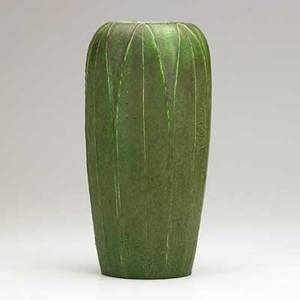 Wilhelmina post grueby tall vase with leaves matte green glaze boston ca 1905 circular faience stamp wp illegible numbers x 11 12 x 5 12
