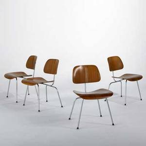 Charles  ray eames herman miller set of four dining chairs dcm usa 1950s walnut chromed plated steel and rubber foil labels each 30 x 19 x 21