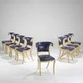 Style of versace set of eight dining chairs italy 1980s leather painted wood and brass trim unmarked 33 x 20 12 x 23