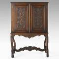 Jacobean style cabinet walnut with carved door and side panels early 20th c 60 x 41 x 22
