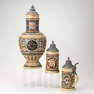 Reinhold hanke stoneware master stein and two personal steins decorated with cherubs 19th20th c marked tallest 17