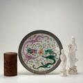 Asian group four pieces 19th20th c two blanc de chine ladies of mercy figures republic period charger with unglazed border and fighting dragons and carved cylindrical wooden box decorated with w