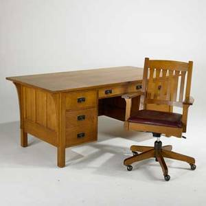 Stickley by audi contemporary prairie style executive desk with paneled back and sides and matching swivel desk chair with vinyl seat late 20th c quartersawn oak and oak veneer brandedmetal tag