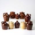 Roycroft ten glazed ceramic vessels four lidded pots and six jugs all marked largest 5 34