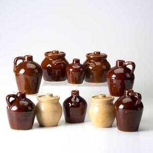 Roycroft ten glazed ceramic vessels four lidded pots and six jugs all marked largest 5 34