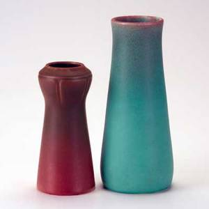 Rookwood two production vases taller in teal glaze 1907 and shorter in green over pink glaze 1912 marked taller 10