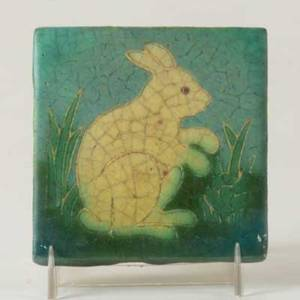 Grueby tile decorated in cuenca with an ivory rabbit in cabbage field marked artists initials et 4 18sq