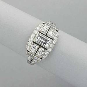 Art deco diamond platinum ring ca 1930 principal emerald cut diamond approx 50 ct with circular and baguette cut melee diamonds approx 140 ct tw throughout in pierced lateral setting 36