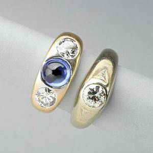 Two gypsy style rings with diamonds 19301950 threestone ring with two diamonds and sapphire cabochon 18k wg with single diamond three transitional cut diamonds approx 170 cts tw 95 dwt