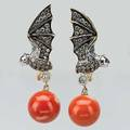 Colored diamond and coral bat earrings contemporary 18k yg and wg bats with champagne and colorless diamond wings approx 1 cts tw ruby eyes suspend 105mm coral beads 77 dwt 122 gs