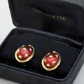 Jean schlumberger for tiffany  co enameled gold earrings translucent red enamel on oblate bombe applied gold in diamond and button shapes 18k clips for unpierced ears in original box 130 dwt