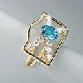 Aquamarine and diamond gold ring ca 1980 architectural form centers oval faceted aquamarine 2 cts crossed by 12 brilliant cut diamonds approx 1 cts tw 71 dwt 112 gs size 6 12 1