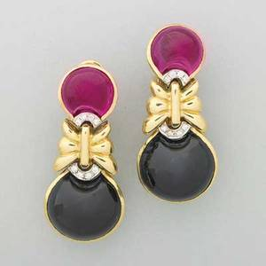 Gold and gemstone pendant earclips italy ca 19801990 flexible 18k in the style of bulgari with shaped onyx and lab grown ruby cabochons with diamond accents 267 dwt 416 gs 1 34