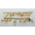 Two unique gold charm bracelets 18701970 fancy link bracelets and 20 charms include fine jeweled treasure chest jewelers tweezers with diamond gem filled trophy cup volkswagen beetle etc most