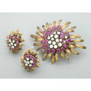 Diamond and ruby gold brooch and earrings ca 1955 designed as prong set gem clusters among leafy fronds brooch with hinged double pin clasp along with matching clip earrings in 14k yg twentysix