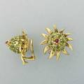 Jean schlumberger for tiffany  co gemset gold thistle earrings circular cut peridot thistle with cabochon ruby tip in 18k yg clip backs for unpierced ears marked 874 dwt 136 gs 1
