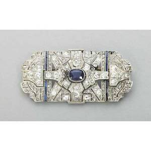 Art deco diamond and sapphire platinum brooch a pierced panel of symmetric geometry with omc oec and rose cut diamonds approx 350 cts tw cushion cut sapphire approx 90 ct sapphire channels