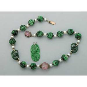Chinese carved jade ca1900 pierced oval pendant depicts insect on foliage platinum 1 34 bead necklace carved jade links hollow jade balls pearls tourmaline silver and gold 18