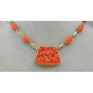Art deco gold and chinese carved coral necklace pierced tablet floral motif conceals clasp oblate beads join oval links 14k possibly e richardson 187 dwt 29 gs 15