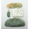 Chinese carved jade and nephrite jewelry white jade square pierced panel depicts dragon carp on gold brooch mount bat pendant mango and gold foliage pendant largest 4