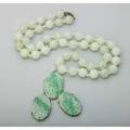 Jade necklace and pendant 20th century 28 strand of 1225mm beads and a gold enhancer formed of 3 pierced oval panels 3