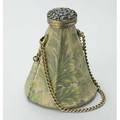 Jeweled gilt silver and brocade evening bag ca 1930 conical form pierced floral overlaid lid set with emeralds and sapphires conceals mirror hinged as clasp silk brocade pouch in leaf design on