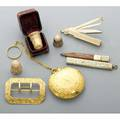Seven 14k american gold accessories 19001930 battin  co bonbonniere with etched scroll 2 on finger chain scroll decorated sash buckle unmarked three thimbles one cased by bigelow kennard
