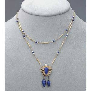 Egyptian revival diamond lapis gold lavalier ca 1925 lapis pharoah cameo on 18k and rose cut diamond panel suspends two lapis amphora 14k fetter link swag chain with seed pearls and lapis beads 7