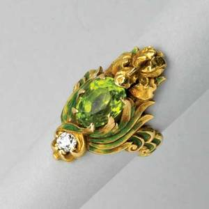 Marcus  co art nouveau enameled gold ring 1904 oval faceted peridot and a diamond entwined by green enamel foliage below an iris blossom a second diamond centers undulating shank marked marcus