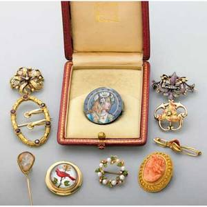 Collection of gold or silver jewelry 18801930 bloomed gold and conch cameo brooch reverse painted crystal intaglio gold brooch depicts cardinal trout fly specimen under shaped crystal and gold st