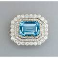 Tiffany  co aquamarine and diamond brooch ca 1890 rectangular step cut aquamarine approx 19 cts framed by triple rows of oec diamonds approx 7 cts tw platinum topped 18k yg removable bro