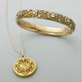 American gold and diamond jewelry ca 1910 10k hinged bangle with five oec diamonds in raised flower heads on meandering vines 14k rococo revival locket with cushion cut diamond on later snake link