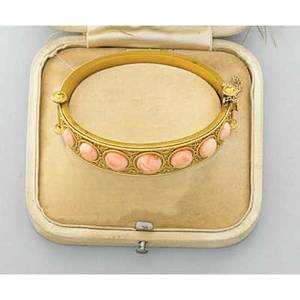 Archeological revival gold and coral bracelet ca 1880 hinged bracelet with 7 round coral cabochons precise granulation and applied wire work bloomed 18k gold in original box unmarked 163 dwt