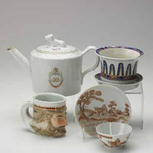 Chinese export grouping four items 19th c teapot with foo dog finial planter with underplate cup and saucer with a farmer tending his cow and figural mug largest 6 x 9 x 5