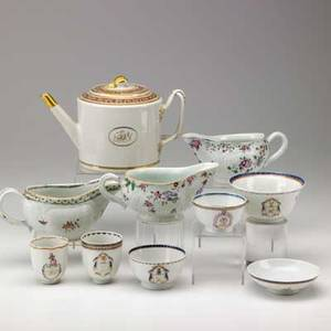 Chinese export ten items late 18thearly 19th c covered rice bowl and four cups with various armorial crests two teapots with banding and sepia rose decoration and three sauceboats with famille r