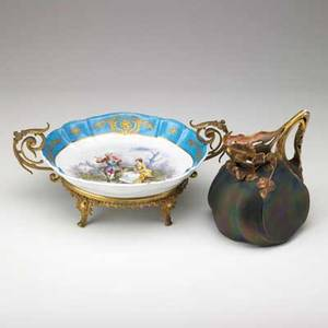 Austrian porcelain transfer decorated gilded bowl in bronze holder and karlsbad iridescent pitcher with gilded leaf highlights 20th c larger 14 x 6 34 x 6 14