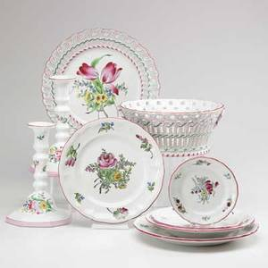 Keller  guerin luneville faience thirtysix pieces of floral decorated faience 19th20th c includes pair of candlesticks openwork bowl and underplate twelve dinner plates eight bowls six bre