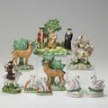 English staffordshire nine items 19th c three bocage figures pair of swan inkwells pair of cat figures and the welsh tailor and his wife largest 6 12 x 6 12 x 5