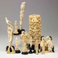 Asian ivory fourteen items 20th c pair of carved birds two pair of carved horses reticulated carved tusk section and nine assorted figures tallest 11 34 with stand